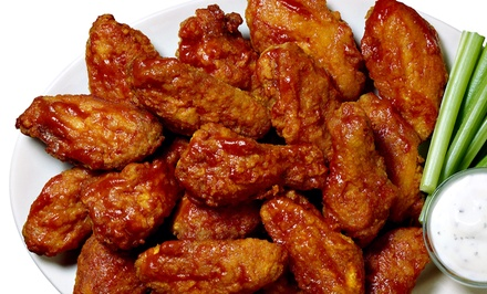 Two or Four Groupons, Each Good for $10 Worth of Wings, Fish, and Sides at Saks Wing Shak (Up to 40% Off)