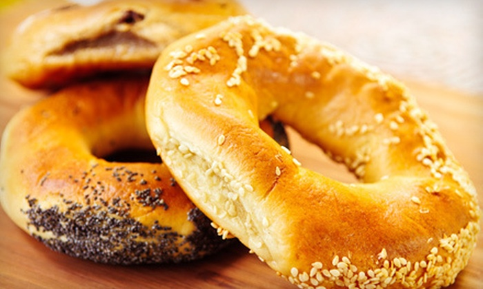 New York Bagel Cafe' & Deli - Pike Creek-Central Kirkwood: 13 Bagels or 5 or 10 Breakfast Sandwiches with Coffee at New York Bagel Cafe' & Deli (Up to 64% Off)