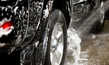 Basic Car Washes with Optional Interior Details at Tire District (Up to 53% Off). Four Options Available.