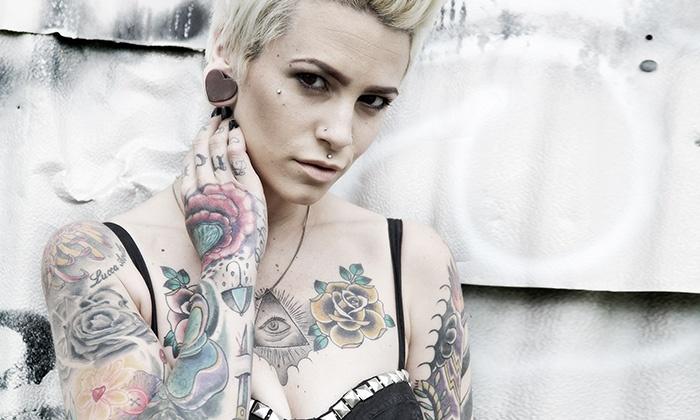 Tataway Laser Tattoo Removal - Tataway Laser Tattoo Removal: Three RevLite Tattoo-Removal Sessions at Tataway Laser Tattoo Removal (Up to 41% Off). Three Options Available.