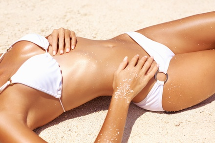 One, Two, or Four Spray Tans at Salon De Nichole (Up to 58% Off)