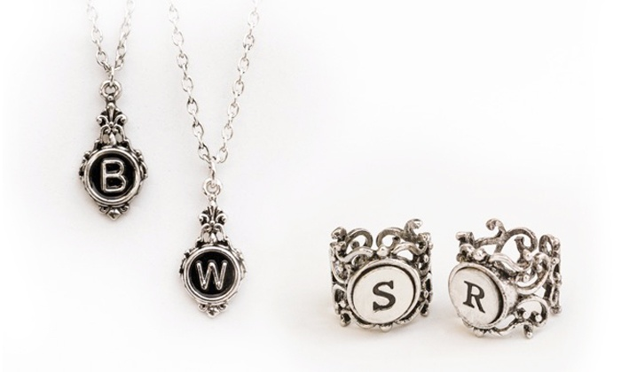 Stamp the Moment: One or Two Personalized Typewriter Necklaces or Rings from Stamp the Moment (Up to 77% Off)