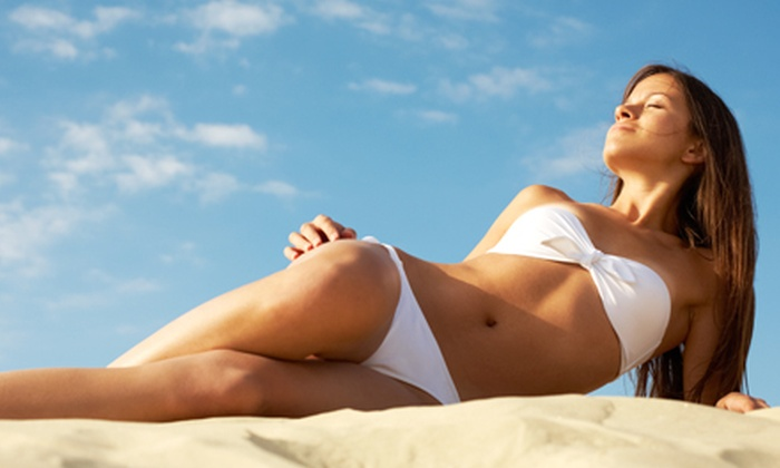 Beyond Bronz'd - Houston: Month of Unlimited UV Tanning with Optional Body Wraps, or Three VersaSpa Spray Tans at Beyond Bronz'd (Up to 88% Off)