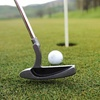 Up to 45% Off Nine Holes of Golf at Mulligans Golf and Pub