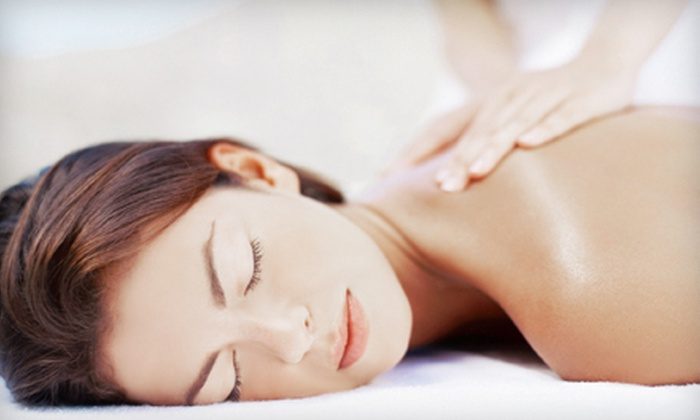 Beauty Essentials Day Spa - Oakhurst: Custom Massage for One, or Couples Massage with Jacuzzi Session, Mimosas, and Light Refreshments (Up to 55% Off)