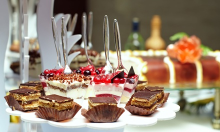 One or Two Dozen Cupcakes or a Candy and Assorted Mini-Dessert Buffet from Sugar Buzz Buffet (Up to 53% Off)