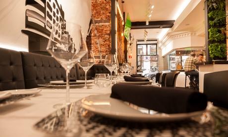 Menú en barra o en mesa para dos con principal, postre y/o café y botella de vino o bebida desde 19,95 € en Madrid Grill