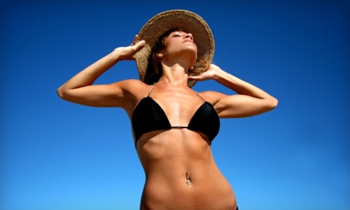 Voila Tans - Sedalia: $24 for $50 Worth of Tanning or Waxing at Voila Tans in Highlands Ranch