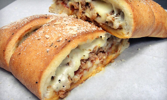 Guys Pizza Co. - Plain: Two Calzones with Nachos or Guys Fries, or $8 for $16 Worth of Pizza at Guys Pizza Co.