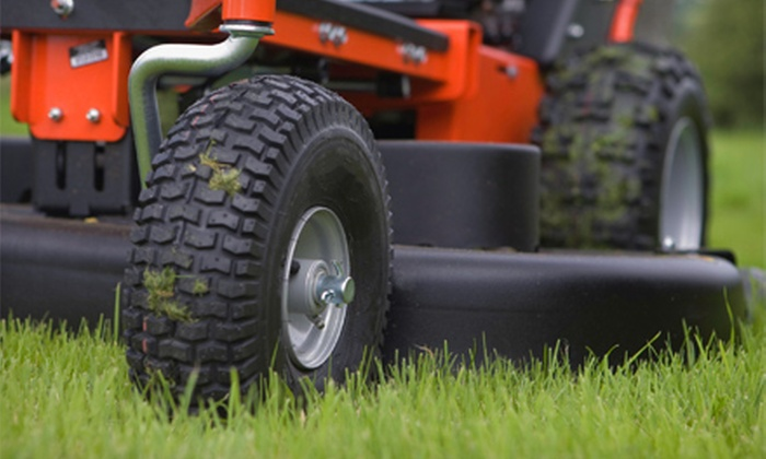 Bellaire Yard Care - Toledo: Lawn Aeration with Seeding or Seasonal Cleanup with Mow from Bellaire Yard Care (Up to 59% Off)
