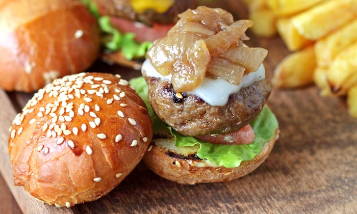 The Lodge Sports Grille - Multiple Locations: American Grill Food at The Lodge Sports Grille (Up to 43% Off). Two Options Available.