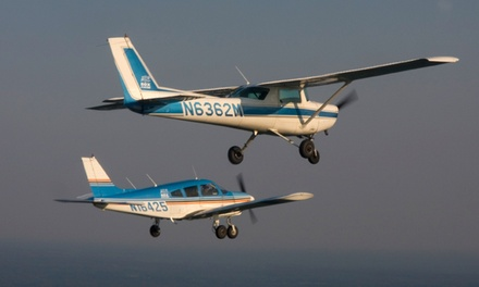 $119 for Introductory Flight Lesson Plus Flight Certificate and Koozie from Box Aviation ($199 Value)