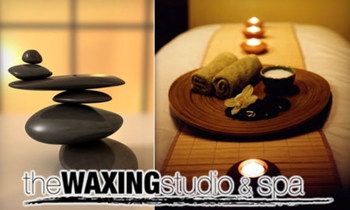 The Waxing Studio & Spa - Clarence: $60 for a Body Wrap or a 90-Minute Deep-Tissue Massage at The Waxing Studio & Spa ($125 Value)