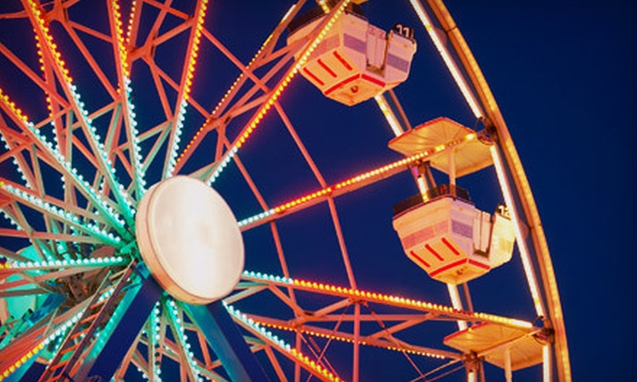 Magical Midways - Multiple Locations: Carnival Day for Two or Four with Unlimited Rides and $10 or $20 Worth of Concessions at Magical Midways (Up to 65% Off)