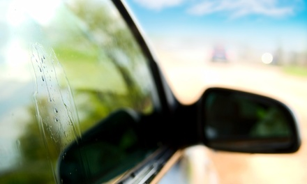 Tinting for Car or Building Windows from Sundown Tint & Auto Glass (Up to 57% Off). Three Options Available.