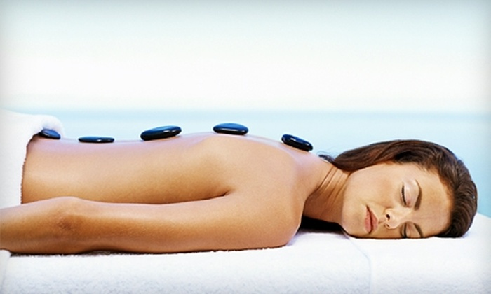 Amazing Cuts Hair Salon and Spa - Stubbs-Stewart: $40 for a One-Hour Warm-Stone Massage or a Chocolate Skin-Peel Facial ($80 Value) at Amazing Cuts Hair Salon and Spa