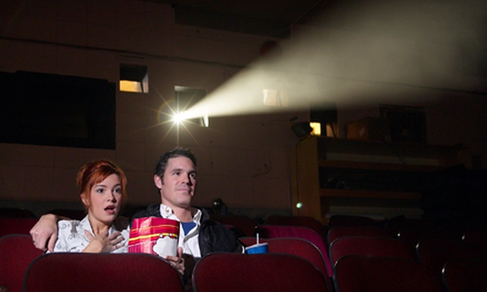 Alaska Experience Theatre - Downtown: $24 for Cult Classic Four-Movie Package with Popcorn and Drinks for Two at Alaska Experience Theater (Up to $56 Value)