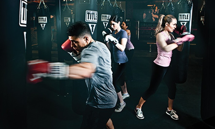 TITLE Boxing Club - Multiple Locations: Three or Six Kickboxing or Boxing Classes with Hand Wraps at Title Boxing Club (78% Off)