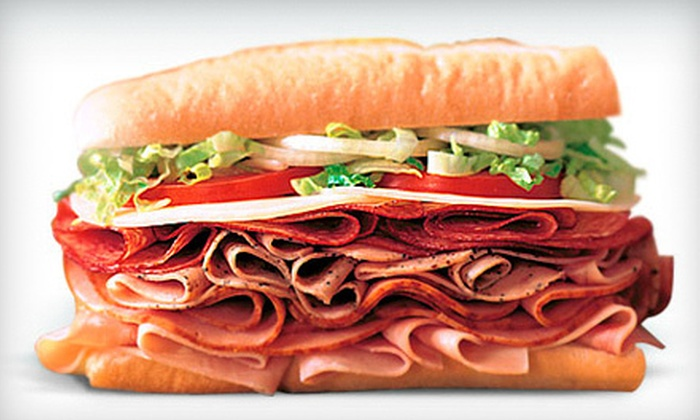 Blimpie - Oak Lawn,Turtle Creek: Foot-Long Sub Sandwich Meals with Chips and Regular Drinks for Two or Four at Blimpie (Up to 57% Off)
