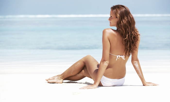Sun Kiss Tan - Multiple Locations: Mystic Spray Tans or One Month of Unlimited UV Tanning at Sun Kiss Tan (Up to 66% Off). Four Options Available.