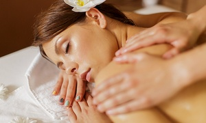 Spa J'adore: Massage with Optional Facial, Sauna Access or Chocolate Body Wrap at Spa J'adore (Up to 61% Off)