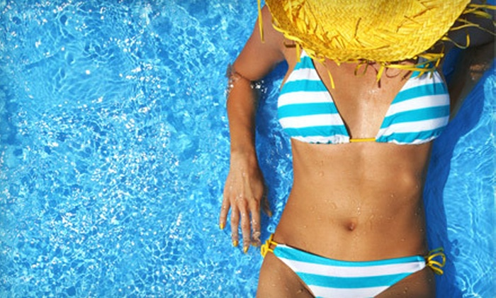 The Solar System - Framingham: One or Three Spray Tans or $30 for $60 Worth of UV Tanning at The Solar System in Framingham