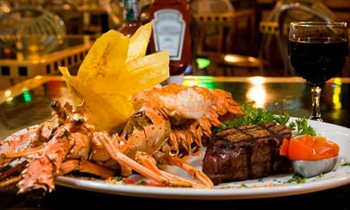 Catch of the Day - Multiple Locations: $15 for $35 Worth of Surf 'n' Turf or $35 for an All-You-Can-Eat Stone Crab Meal for Two ($77.98 Value) at Catch of the Day