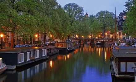 ✈ 7-Day Tour of Amsterdam, Bruges, and Paris with Airfare. Price/Person Based on Double Occupancy.