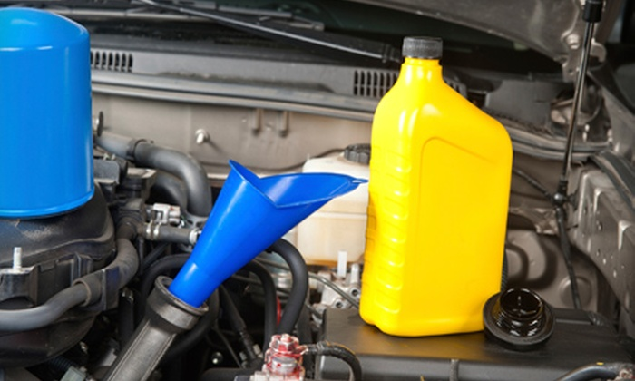 Arvid's Tire & Auto Care - Multiple Locations: $29 for an Oil-Change Package Including Vehicle Inspection at Arvid's Tire & Auto Care ($69.95 Value)