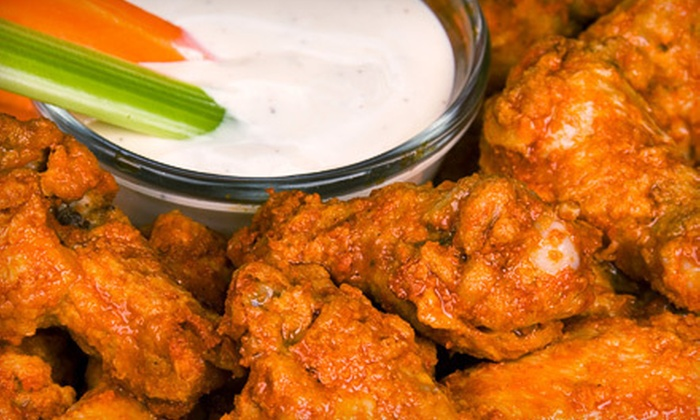 Friday Knight Lights - London: $15 for $30 Worth of Pub Fare and Drinks at Friday Knight Lights