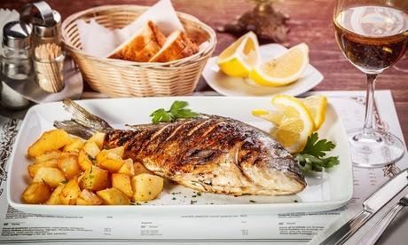 Parrillada de pescado o carne para 2 con entrantes, botella de vino, jarra de cerveza o sangría desde 24.95 € en Goyo Oferta en Groupon