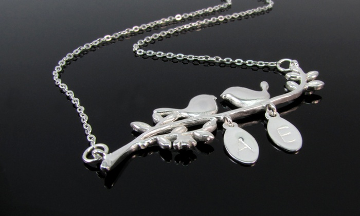 NameJewelrySpot: $29.99 for a Silver Love Bird Initial Pendant Necklace from NameJewelrySpot ($119.99 Value)