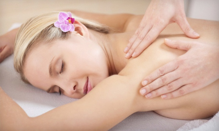Rising Lotus Yoga and Massage - Multiple Locations: One or Two Massages, or One Massage and Unlimited Yoga at Rising Lotus Yoga and Massage in Fort Collins (Up to 58% Off)