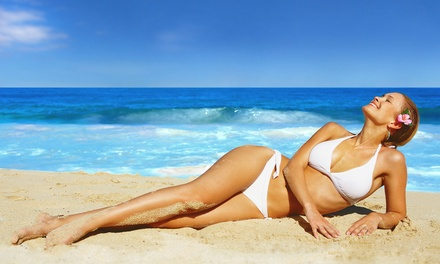 One or Three Spray-Tan or UV-Tan Sessions or One Airbrush Tan at Total Tan (Up to 74% Off)