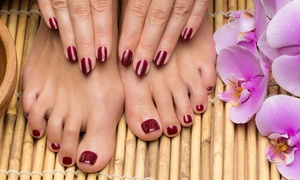 Illinois Nails: One Deluxe Mani-Pedi with Paraffin Wax or a Full Set with No-Chip Polish at Illinois Nails (Up to 51% Off).