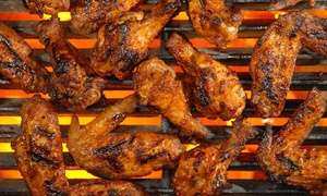 Sports Grill: Wings, Ribs, and Comfort Foods at Sports Grill (Up to 45% Off). Two Options Available.