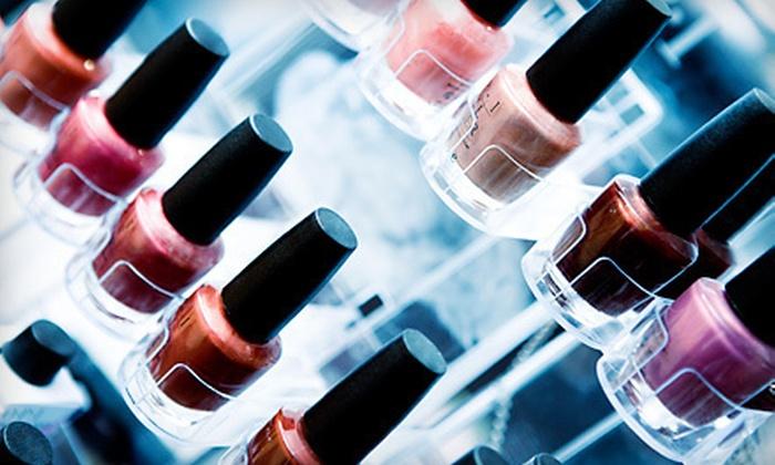 KM Nails - Farmington: $26 for a Shellac Manicure and Spa Pedicure at KM Nails in Farmington Hills ($52 Value)