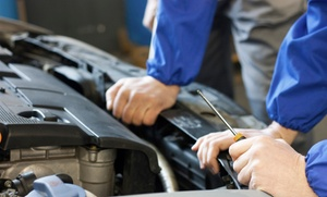 Jerrysautocarecenter: Two Oil-Change Packages with Tire Rotations and 30-Point Safety Inspections from Jerry's Autocare Center (45% Off)