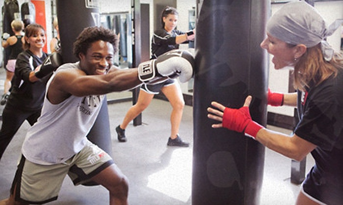 TITLE Boxing Club - Multiple Locations: Two Weeks or One Month of Unlimited Boxing Classes and Hand Wraps at Title Boxing Club (62% Off)