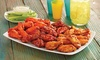 Hurricane Grill & Wings - Palm West: Chicken-Wing Meal for Two or Four with Fries and Soft Drinks at Hurricane Grill & Wings (39% Off)