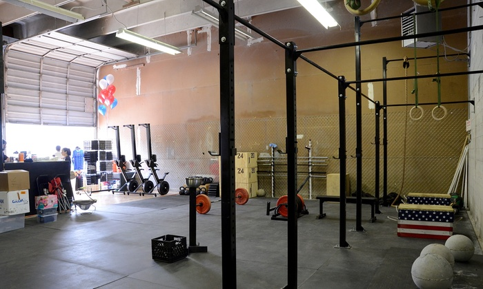American Barbell Club - Gainesville: Four Weeks of Unlimited Fitness Classes at American Barbell Club (65% Off)