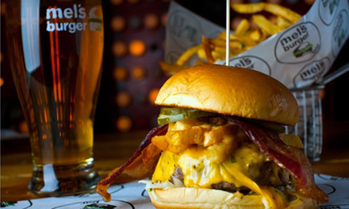 Mel's Burger Bar - Morningside Heights: Two Burgers and a Half-Gallon Growler of Beer at Mel's Burger Bar. Four-Person Option Available (Up to 56% Off).