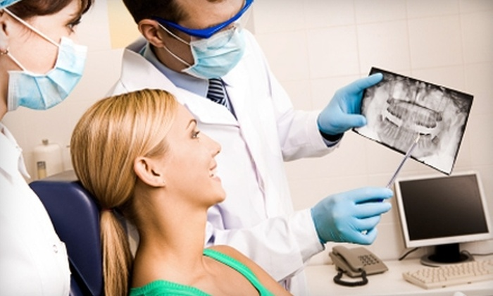 Oak Brook Smiles - Oakbrook Terrace: $49 for an Initial Exam, Cleaning, and X-rays ($350 Value) or $99 for an Implant Consultation and CT Scan ($500 Value) at Oak Brook Smiles in Oakbrook Terrace