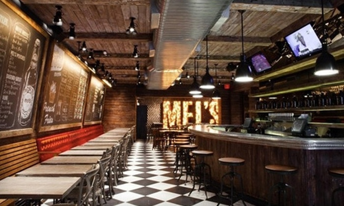 Mel's Burger Bar - Morningside Heights: $19 for Any Two Burgers and a 64 oz. Growler at Mel's Burger Bar (Up to $55 Value)