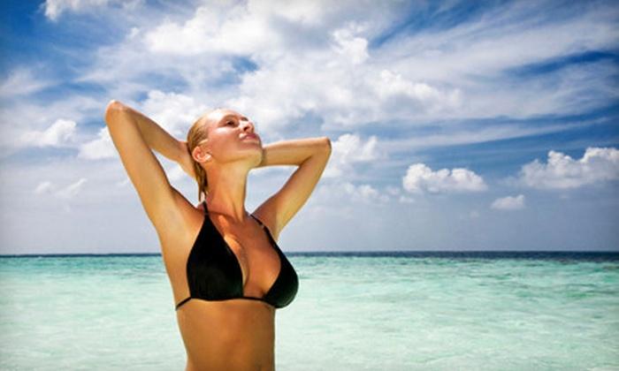 Tropi Tan - Multiple Locations: 3 or 5 Spray Tans at Tropi Tan (Up to 61% Off)