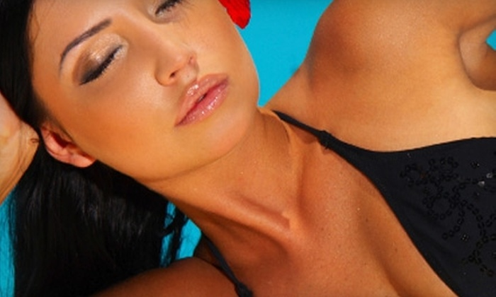 Tan Alaska - Wasilla: $40 for 10 Level-Two Bed Tans or Two Spray Tans from Tan Alaska (Up to $84 Value)