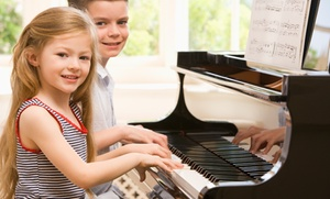 Exploring Music: Two or Four 50-Minute Group Piano Lessons at Exploring Music (86% Off)