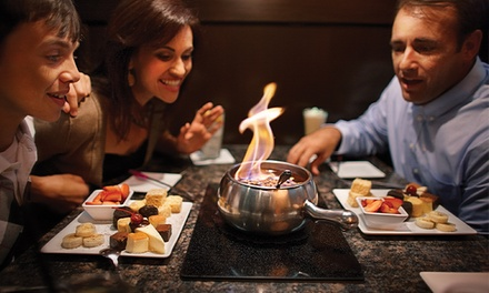 Three-Course Fondue Meal for 2 or 4 with Cheese Fondue, Salad and Featured Entrée at Melting Pot (Up to 38% Off)