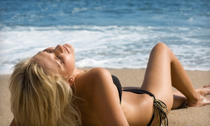 Pacific Tanning - Multiple Locations: One or Three Spray Tans or One Month of Unlimited Tanning at Pacific Tanning (Up to 76% Off)
