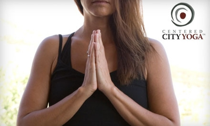 Centered City Yoga - Multiple Locations: $40 for One Month of Unlimited Classes at Centered City Yoga ($125 Value)
